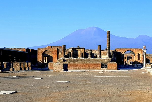 ruins of city of pompeii, naples with mount vesuvius in the background