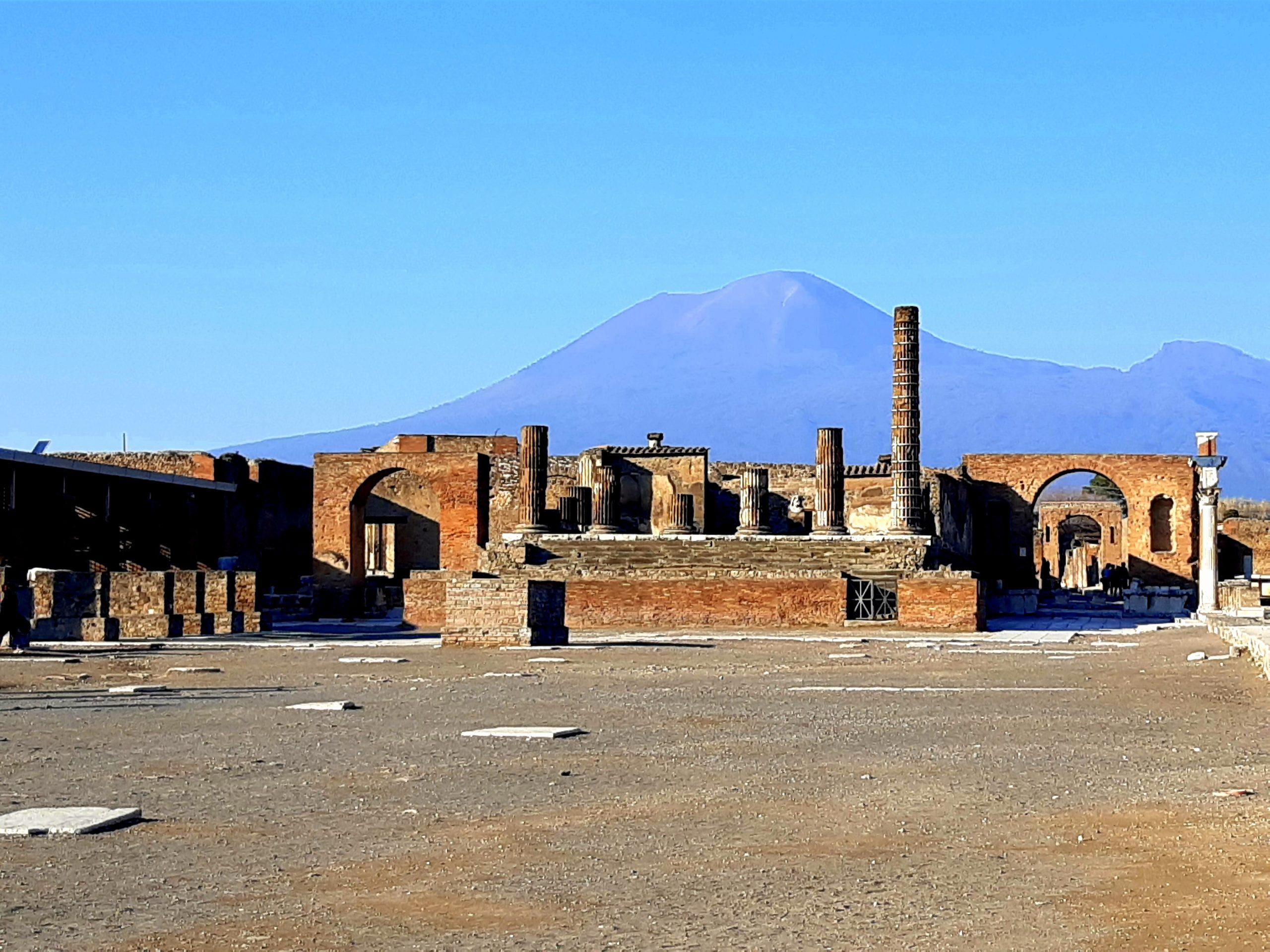 ruins of city of pompeii, naples with mount vesuvius in the background